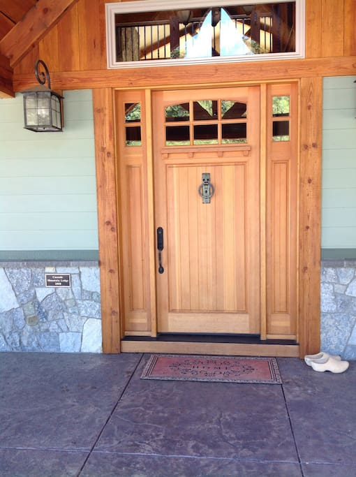 Our impressive Craftsman style front door with custom forged door knocker.