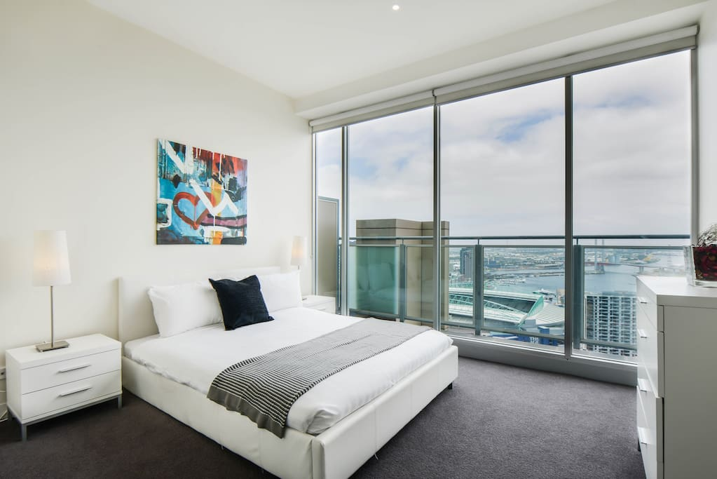 Master bedroom with sweeping view of Victoria Harbour