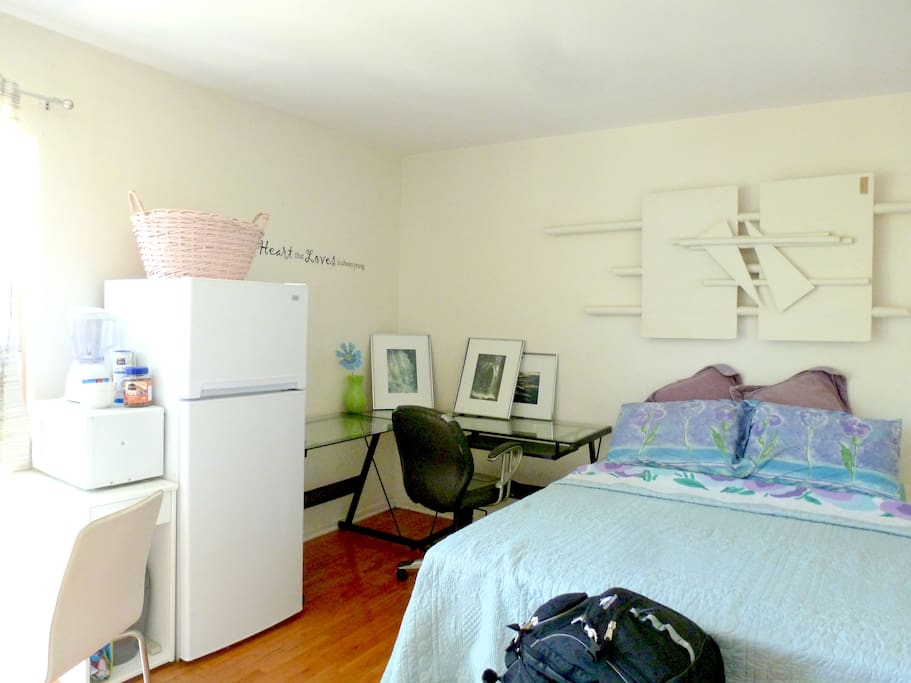New Queen Bed, Desk, Refrigerator with Freezer! Filled with water and ice.