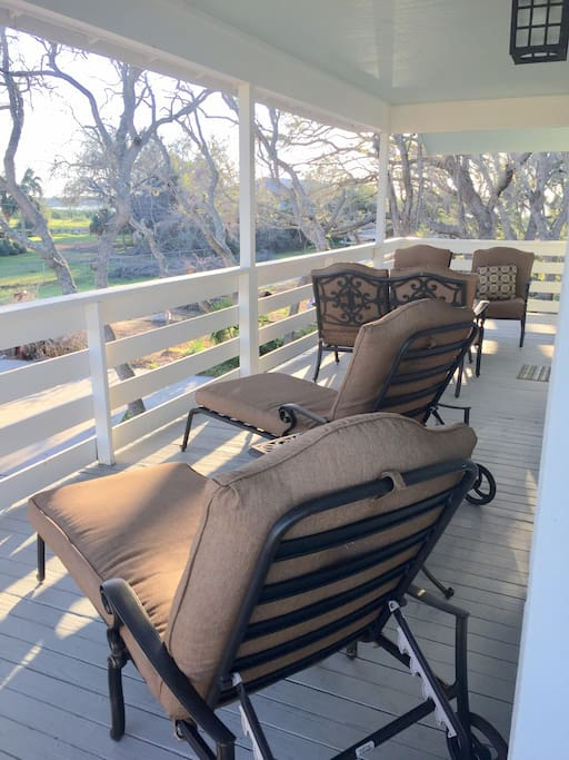 Comfortable patio seating to lounge and enjoy the sunset views over the intercoastal on the westward corner.  Many days you can hear the crash of the ocean waves.  Great place for an afternoon nap or morning coffee.