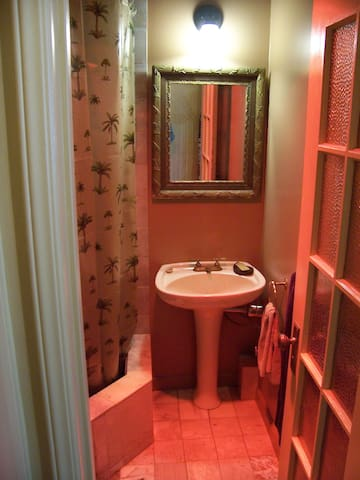 Bath has marble floor and copper lined deep shower you can soak in.