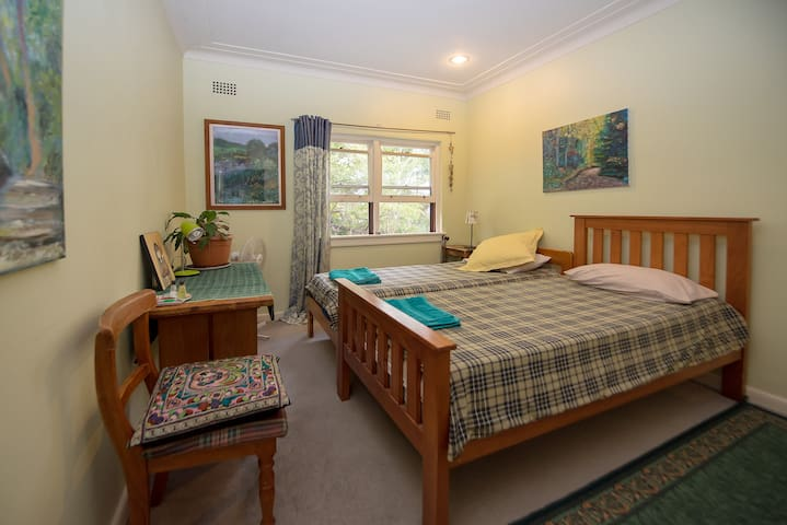 Comfortable bedroom in leafy suburb