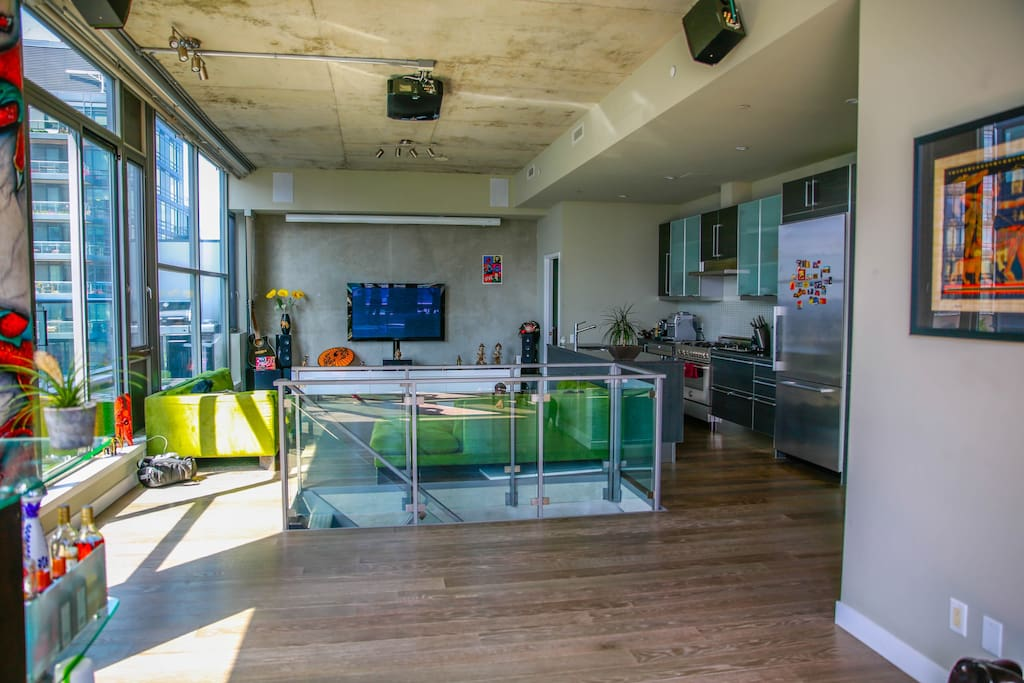 Open concept.  12 Ft exposed concrete cielings.  Floor to ceiling windows with electronic roller blinds