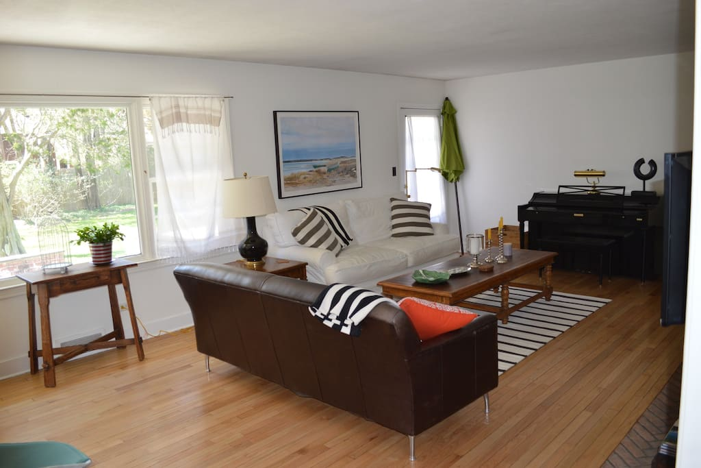 Another view of the spacious living room with a walk out onto the patio.