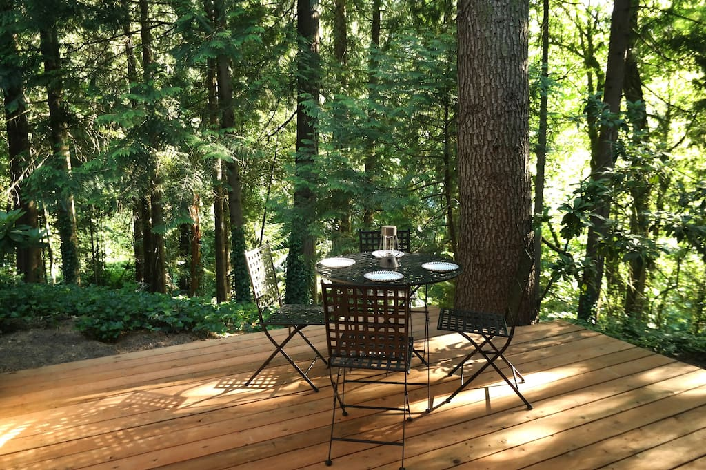 Private deck with calming forest views. Enjoy your morning coffee amongst the trees, and dine outside during magic hour on mild nights.