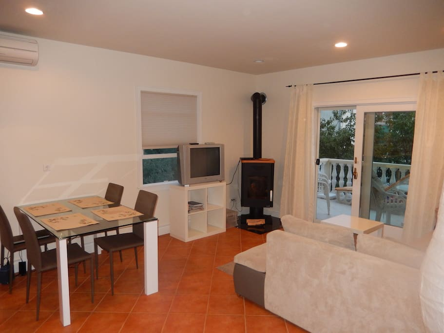 Dining and living area with balcony. Cable TV & Wifi