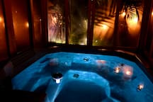 Private Hot tub Enclosed that lights up at night.