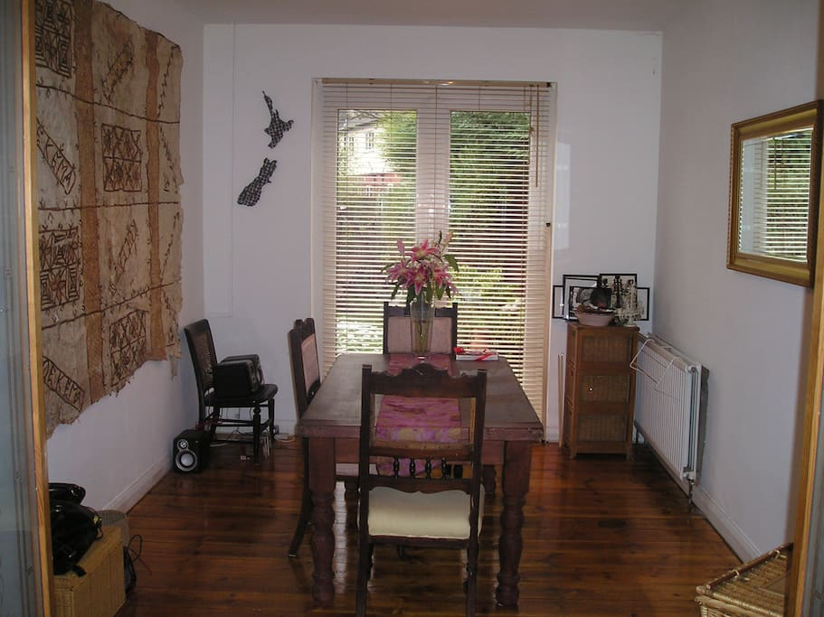 This is the dining room with french doors that open onto the garden.