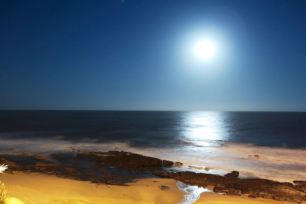 Watch the full moon come up over the ocean.