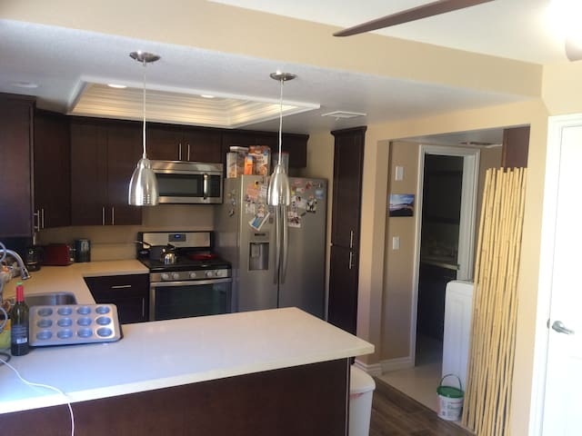 Fully updated and equipped kitchen with fridge, stove, microwave, dishwasher, and keurig coffee maker.  Washer & Dryer available as well.