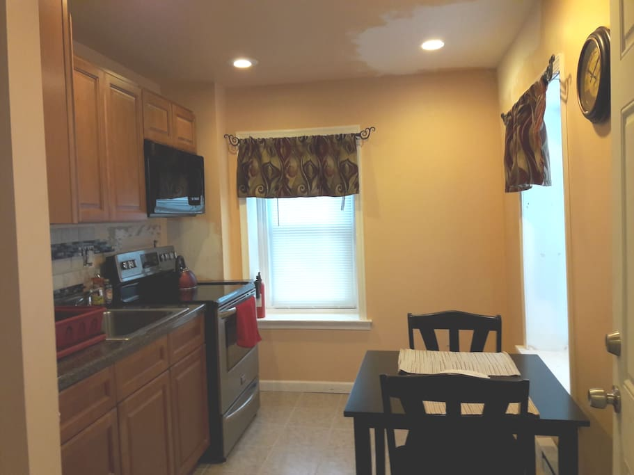 Kitchen with stove and microwave