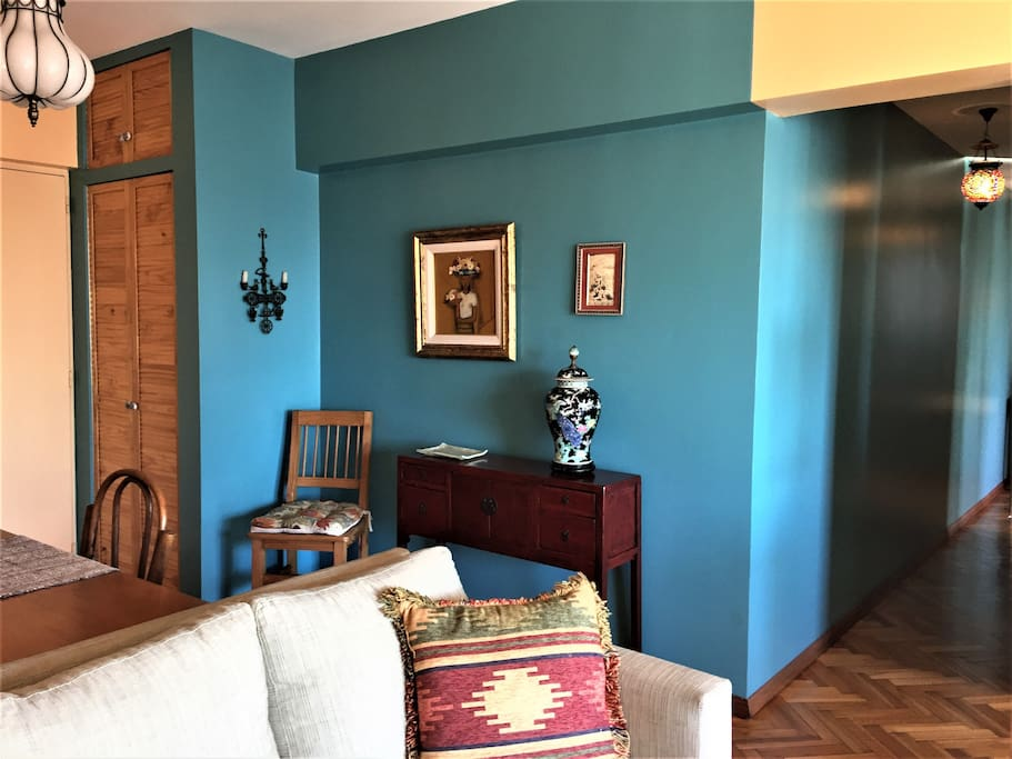 Coat closet at the entry door.  Striking color offsets Chinese, Uruguayan, Persian and Greek art.