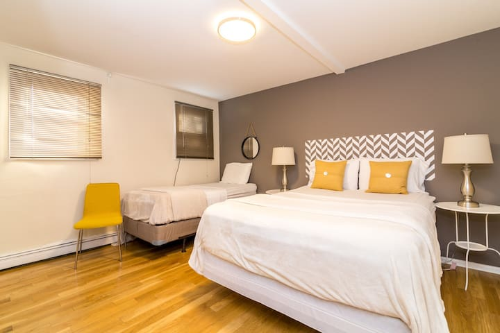Huge master bedroom facing the back of the building for light sleepers with queen and twin bed. Sleeps 3