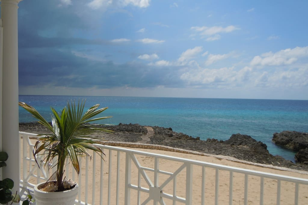 Incredible ocean view from the patio of Cayman Sunset -- rain or shine!