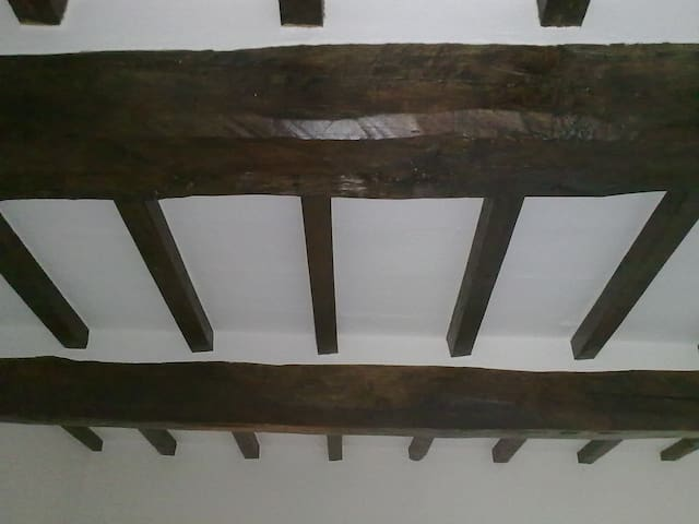 Exposed beams in lounge