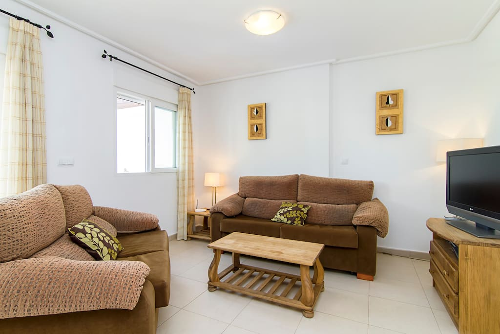 Comfortable seating area with Plasma TV