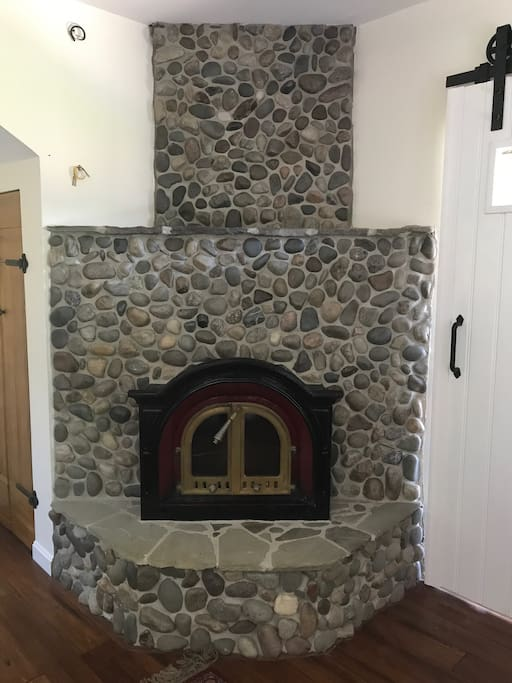 Cozy up to the wonderful  river rock fireplace in your living room
