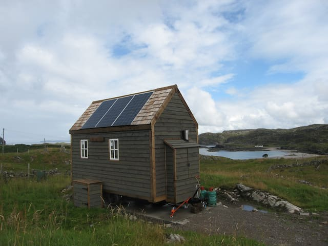 Tiny House from the rear, showing photovoltaic panels