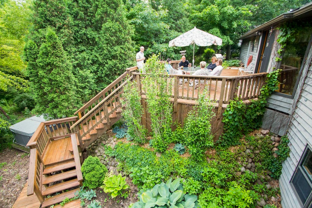 Multi tiered deck overlooking the gardens and leading to the hot tub