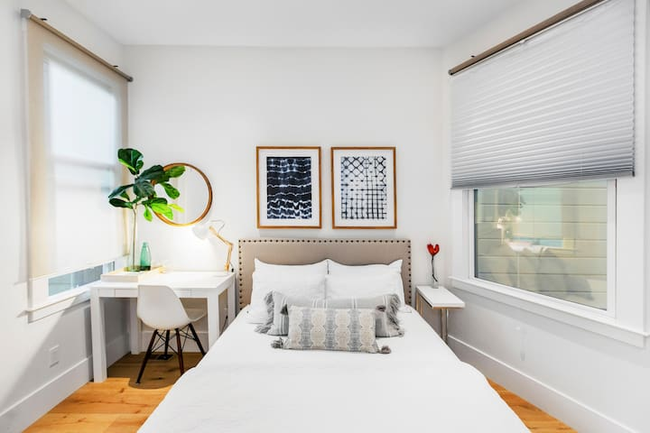 Explore Valencia Street from a Room in a Serene Condo