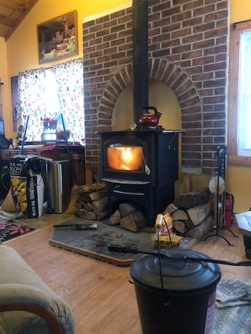 Living room. Warm glow from the wood stove in addition to standard furnace heat.