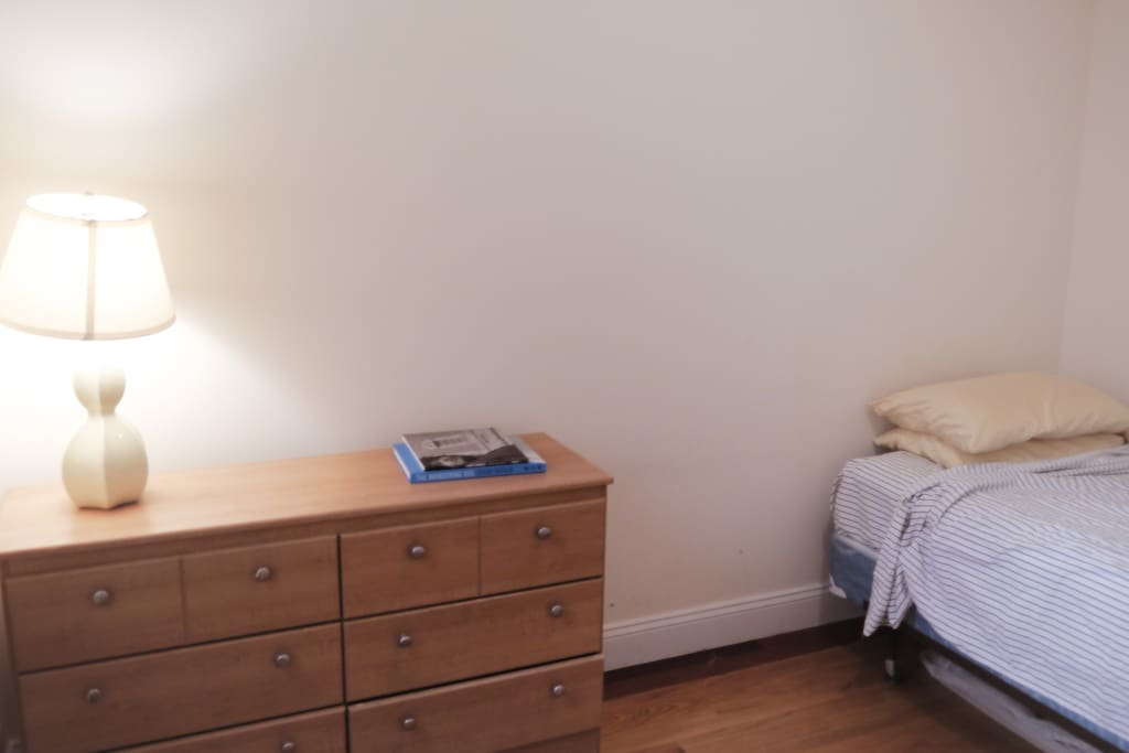 Private guest room with full-sized bed and bureau