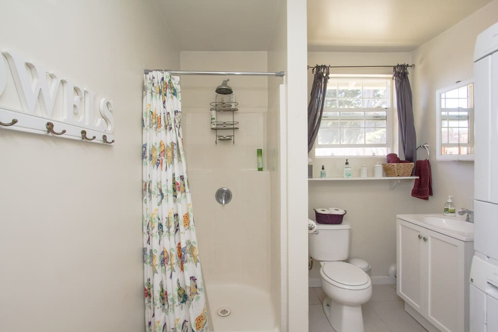 Bathroom with shower and washer and dryer