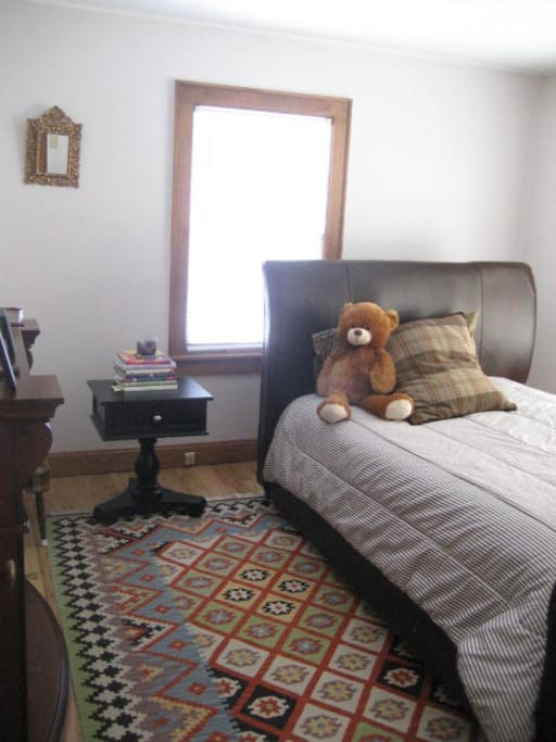 Master Bedroom with queen sleigh bed and electric fireplace