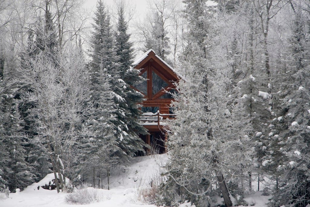 Winter view of the secluded cabin from the lake