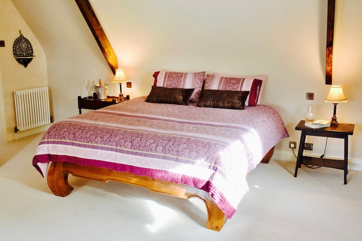 A Queen bed in the Master Bedroom & Honeymoon suite.