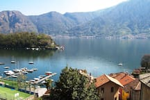 View from across the road outside the apartment overlooking Sala Comacina and Lake Como towards Isola Comacina, the only island in the Lake.