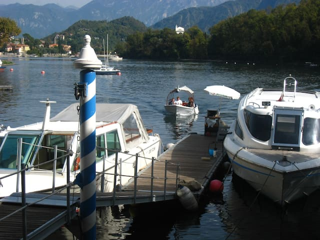 Water taxi arriving from the island where you may enjoy Locanda dell'Isola Ristorante, and bar 'La Botte'