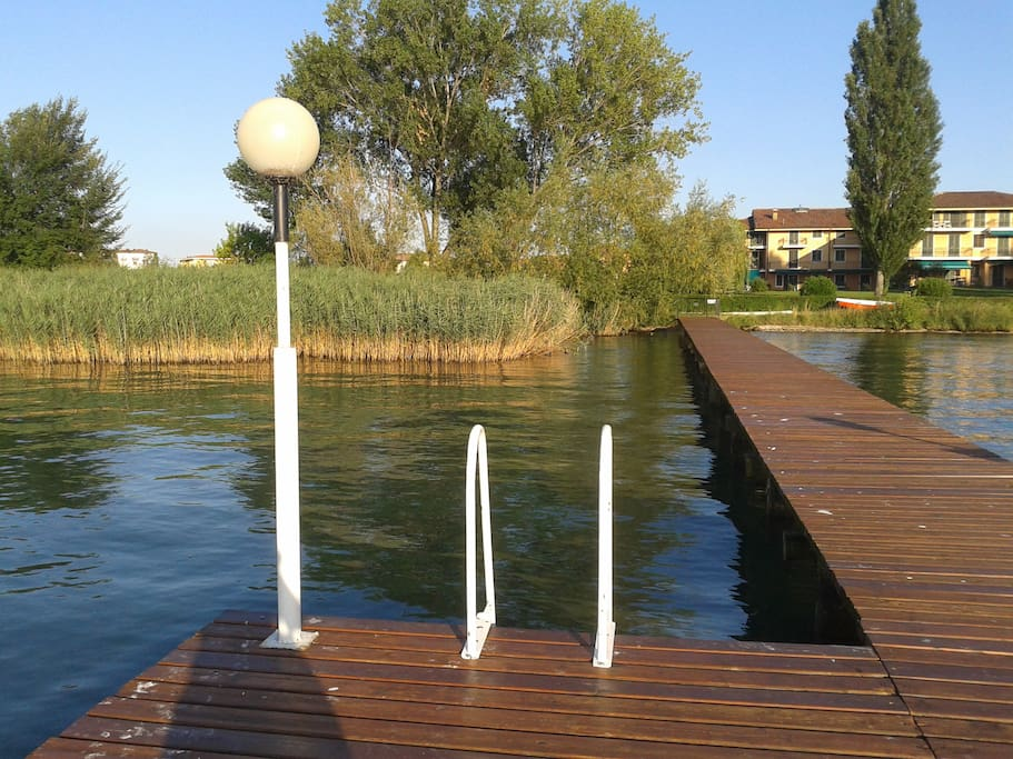 the private dock of the residence, beautiful view... sun and relax!!