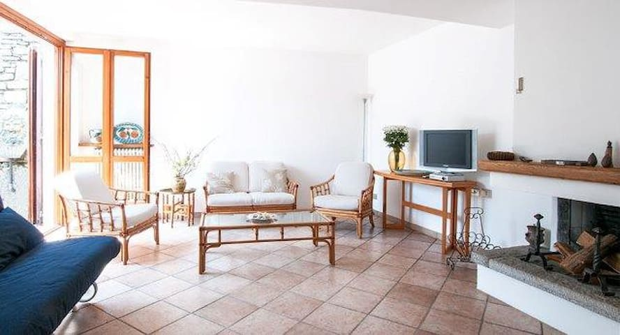 The living room is a wide area to relax and chat with friends or to read a book