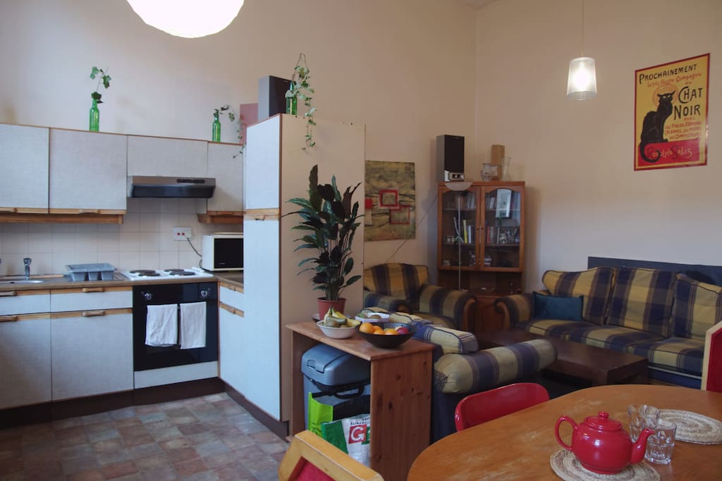 The Sitting Room with Kitchen and Dining table