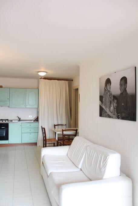 living room + kitchen on the back