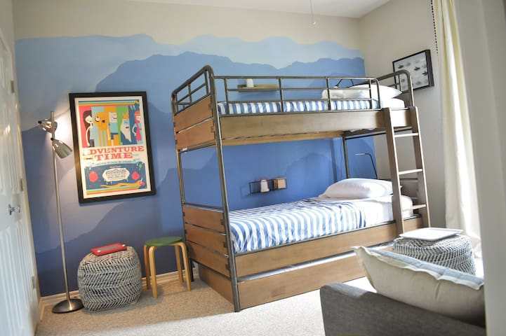 Guest bedroom with a triple bunk bed