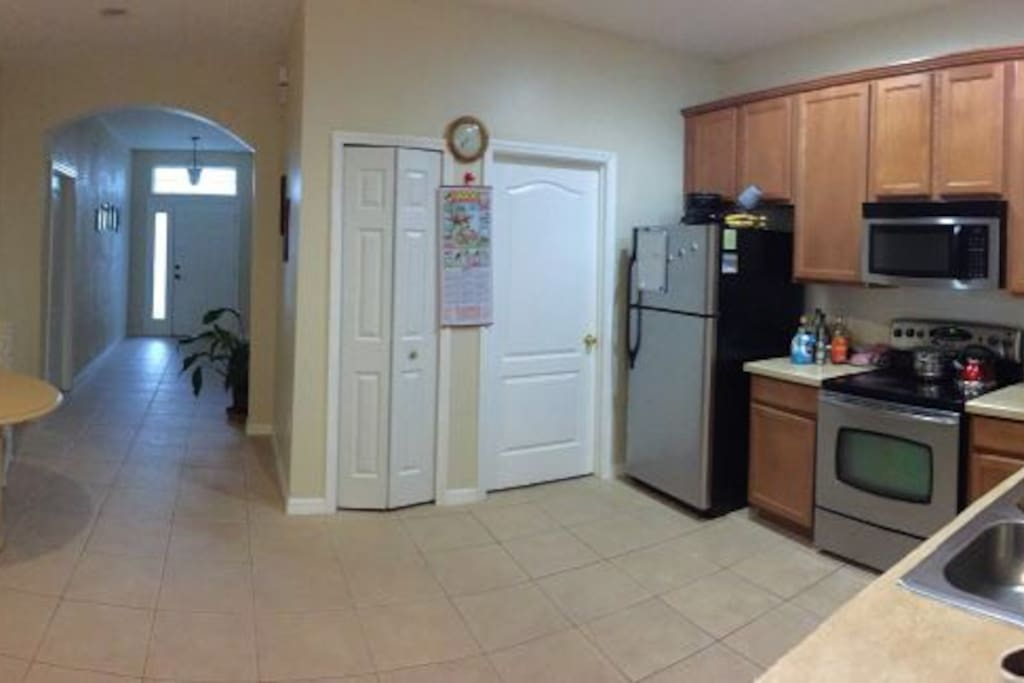 Another angle of kitchen and entrance. Spacious and clean.
