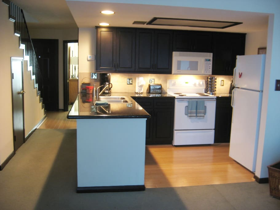 Full kitchen! black granite counter tops and stainless steel sink.