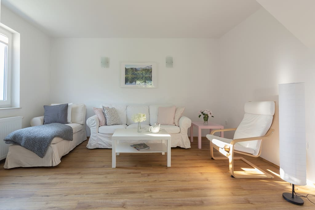 A comfortable sitting room with two coffee tables and a flat screen TV with as many as 265 international TV programmes (including HD programmes).