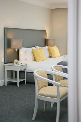 Soothing King Size Bed, Accent Chairs.