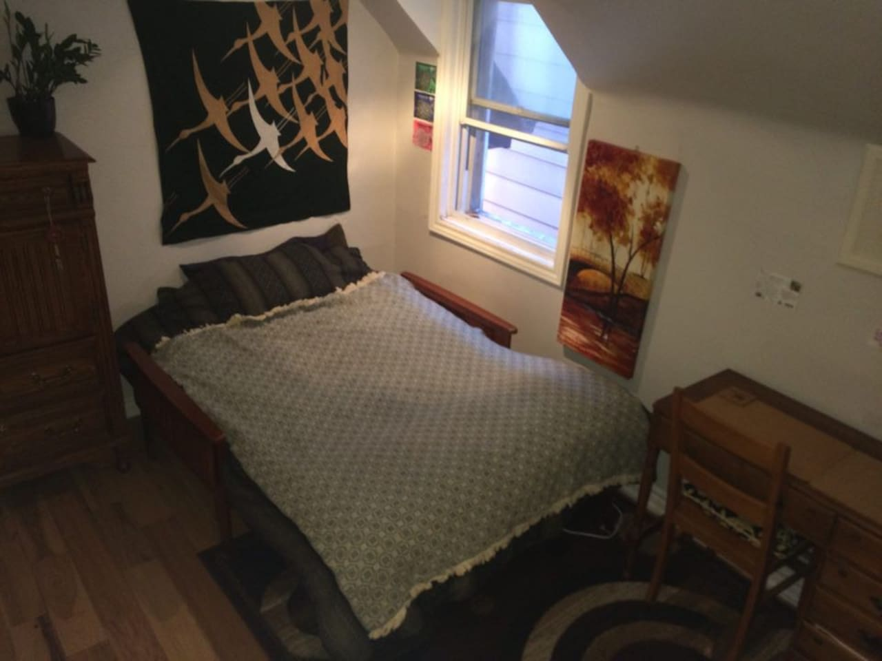 A comfortable & artistic room in our small cozy apt!