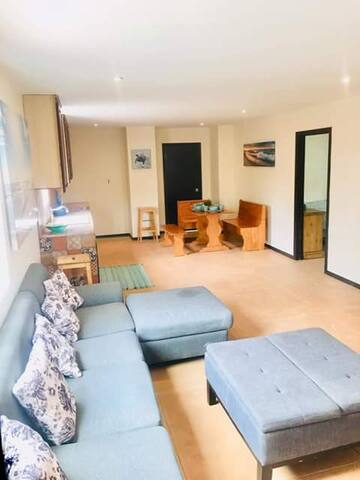 Spacious and open living area perfect for entertaining guests, entertaining, relaxing with your loved ones. Large open and spacious living area next to kitchen that comes with cooking essentials for your convenience and comfort.