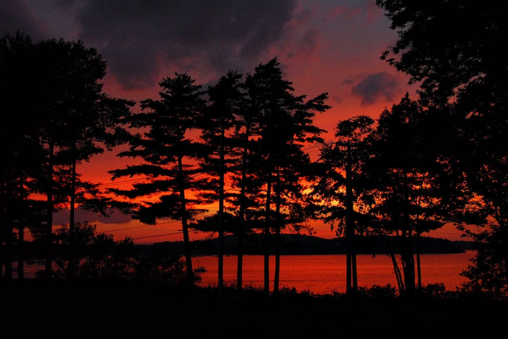 Breathtaking sunsets from right outside your windows or from the Adirondack chairs out front