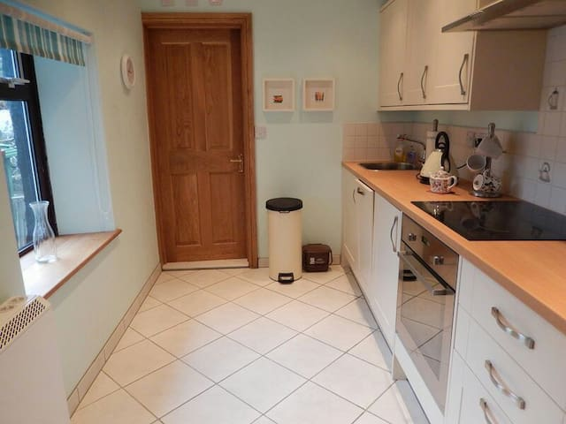 The kitchen is well-appointed with dishwasher, hob, oven, microwave and fridge with freezer compartment