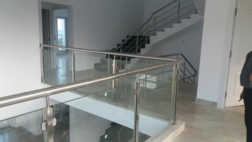mezzanine floor connecting all the first floor bedrooms and visual access to ground floor