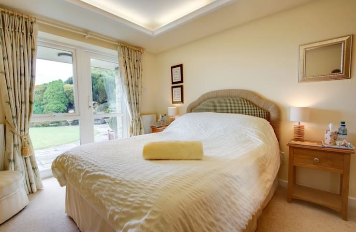 Bed 2 - Hardwick Room - King sized bed. Patios doors to garden.