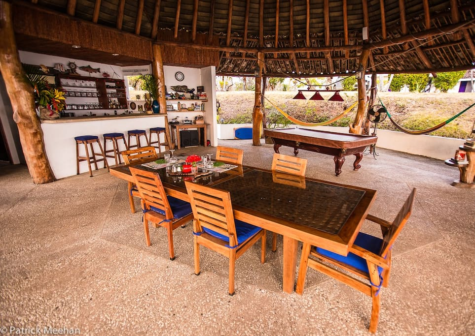 A private, oversize open air rancho is the perfect place to lounge in paradise! A private bar, professional pool table, game chest, Bose stereo, comfy teak deck furniture and hammocks it has plenty of room to dine, lounge, play and rest!