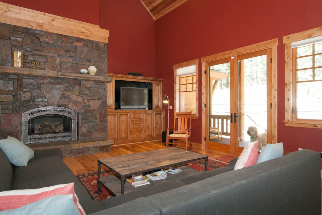 Another view of the living area facing the back patio and gas fireplace