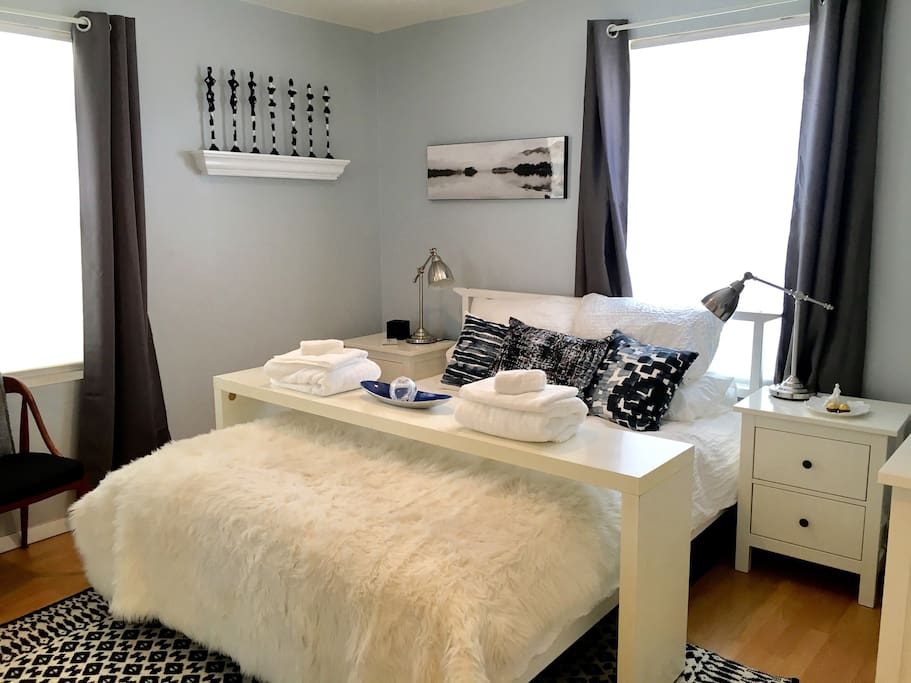 The second bedroom has a comfortable queen size bed and mirror front closet